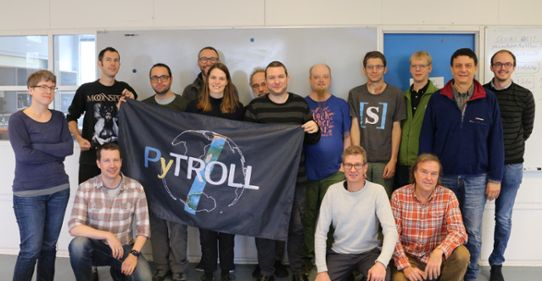 Group with flag at Pytroll tenth year annicersary
